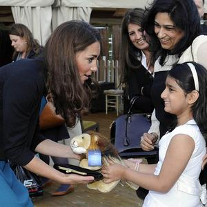 The Duchess of Cambridge is presented with an Aslan lion toy by Suhani Kapoor at a performance of The Lion, The Witch and The Wardrobe