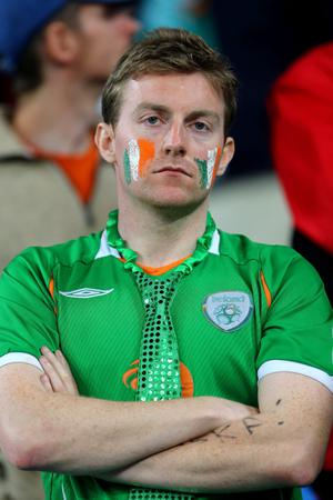 POZNAN, POLAND - JUNE 10:  A dejected Republic of Ireland fan after defeat during the UEFA EURO 2012 group C between Ireland and Croatia at The Municipal Stadium on June 10, 2012 in Poznan, Poland.  (Photo by Christof Koepsel/Getty Images)