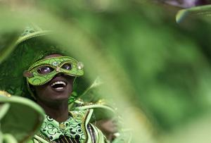 A member of Mocidade Alegre samba school performs in a parade during carnival celebrations in Sao Paulo, Brazil, Sunday March 6, 2011. (AP Photo/Andre Penner)