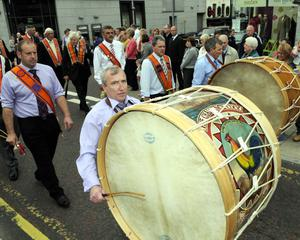 Drummers make their way along the Newry Street Banbridge before going to Rathfriland for the main Parade. Photo Paul BYrne