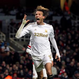 Michu will cost £30m to leave Swansea, according to Michael Laudrup