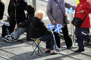 Members of the public await the arrival of Pope Benedict XVI in Edinburgh, Scotland, where he will begin the first papal state visit to the UK