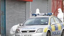Police at the scene in Shaw's Road, Belfast, where three officers were hurt in an explosion