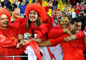 WELLINGTON, NEW ZEALAND - OCTOBER 01:  Centre Siale Piutau of Tonga celebrates with the fans following his team's 14-19 victory during the IRB 2011 Rugby World Cup Pool A match between France and Tonga at Wellington Regional Stadium on October 1, 2011 in Wellington, New Zealand.  (Photo by Mike Hewitt/Getty Images)