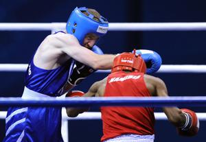 Northern Ireland's Paddy Barnes (blue) competes against Namibia's Jafet Uutoni in the light fly weight final during Day Ten of the 2010 Commonwealth Games at the Talkatora Indoor Stadium in New Delhi, India