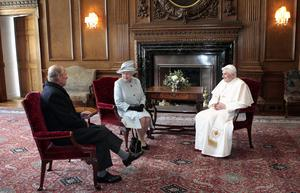Britain's Queen Elizabeth II and the Duke of Edinburgh talk with Pope Benedict XVI during an audience in the Morning Drawing Room at the Palace of Holyroodhouse in Edinburgh