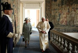 Queen Elizabeth II and Prince Philip, Duke of Edinburgh walk with Pope Benedict XVI to the Morning Drawing Room in the Palace of Holyroodhouse, the Queen's official residence in Scotland