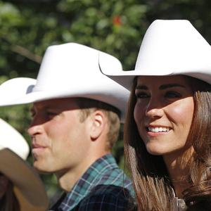 The Duke and Duchess of Cambridge watch the Calgary Stampede parade in western Canada
