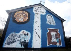 Belfast murals.  A mural off the Newtownards Road dedicated to 'The Lion, The Witch and The Wardrobe' author C.S Lewis who was from the area.  2010.