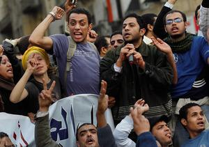 CAIRO, EGYPT - JANUARY 30:  Anti-government protesters chant and sing in Tahrir Square January 30, 2011 in Cairo, Egypt. Cairo remained in a state of flux and marchers continued to protest in the streets and defy curfew, demanding the resignation of Egyptian president Hosni Mubarek. As President Mubarak struggles to regain control after five days of protests he has appointed Omar Suleiman as vice-president. The present death toll stands at 100 and up to 2,000 people are thought to have been injured during the clashes which started last Tuesday. Overnight it was reported that thousands of inmates from the Wadi Naturn prison had escaped and that Egyptians were forming vigilante groups in order to protect their homes.   (Photo by Chris Hondros/Getty Images)