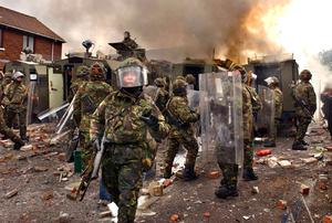 September 2005 Army landrovers burn during serious rioting in a loyalist area of west Belfast on Saturday following the re-routing of an Orange Order march. Automatic gunfire and blast bombs were used against the police and army and three armoured military vehicles were destroyed by the rioters. Picture by Crispin Rodwell