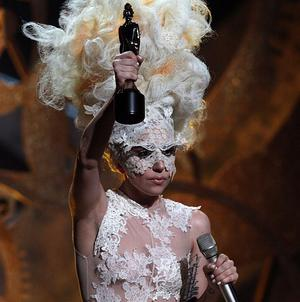 Lady Gaga holds aloft the International Female Solo Artist award at this year's Brits