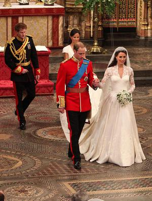 Prince William and his new bride Kate walk leave Westminster Abbey, London, following their marriage, followed by Prince Harry and Pippa Middleton. PRESS ASSOCIATION Photo. Picture date: Friday April 29, 2011. Photo credit should read: Anthony Devlin/PA Wire