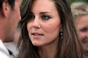 LONDON - JUNE 27:  Kate Middleton (R) and guest attend during the 46664 concert in celebration of Nelson Mandela's life at Hyde Park on June 27, 2008 in London, England.  (Photo by Dan Kitwood/Getty Images)