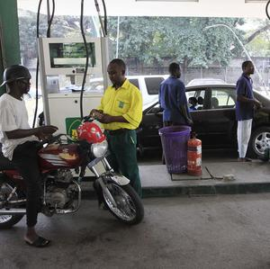 People buy fuel at a petrol station in Lagos, Nigeria, after prices doubled overnight (AP)