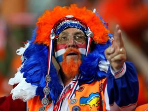 KHARKOV, UKRAINE - JUNE 13:  A Netherlands fan enjoys the atmosphere prior to the UEFA EURO 2012 group B match between Netherlands and Germany at Metalist Stadium on June 13, 2012 in Kharkov, Ukraine.  (Photo by Ian Walton/Getty Images)