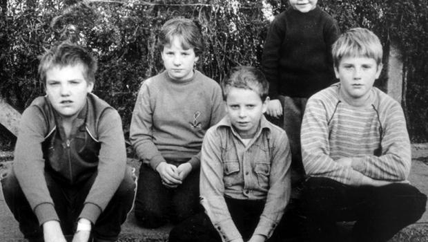 The children who escaped death by inches at Darkley, from left, Graham Ritchie, Helen Wilson, Nigel Wilson, Andrew Reid (standing) and Keith Ritchie, photographed the day after the INLA attack.
