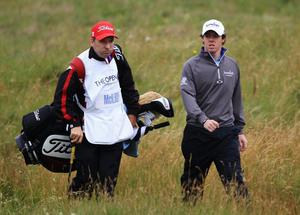 Rory McIlroy of Northern Ireland walks with caddy JP Fitzgerald on the 3rd hole during the first round of The 140th Open Championship at Royal St George's on July 14, 2011 in Sandwich, England.