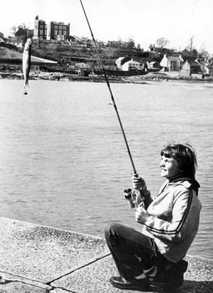 Hooked...young Ian Thompson is out on a sort of busman's holiday for here he is fishing at Ardglass when he could just as easily have fished in Bangor. However, the journey seems to have been worth while and variety is, of course, the spice of life. 11/4/1978