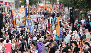 12/7/11 Mandatory Credit Darren Kidd/Presseye.com Orangemen take part in Twelfth of July parades as they make their way to the field at Shaws Bridge, Belfast.The parade makes its way along Royal Av past City Hall