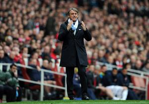 LONDON, ENGLAND - APRIL 08:  Man City manager Roberto Mancini reacts during the Barclays Premier League match between Arsenal and Manchester City at Emirates Stadium on April 8, 2012 in London, England.  (Photo by Michael Regan/Getty Images)
