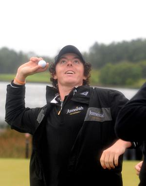 After winning the game Rory McIlroy throws his ball into the crowd at the 18th hole at the Lough Erne Golf Challenge