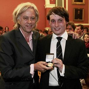 Trinity College Historical Society Auditor Huw Duffy presents Sir Bob Geldof with the society's medal for services to world development
