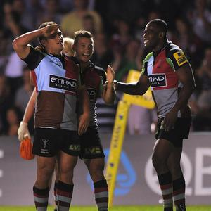 Harlequins' Ben Botica salutes the armed forces in the stands after scoring a try