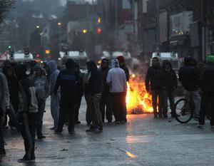Loyalist protesters block of the Newtownards Road Belfast where shots are reported to have been fired on Saturday January 5 2013