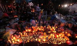 NEWTOWN, CT - DECEMBER 17:  Candles are lit among mementos at a memorial for victims of the mass shooting at Sandy Hook Elementary School, on December 17, 2012 in Newtown, Connecticut. The first two funerals for victims of the shooting were held today.  (Photo by Mario Tama/Getty Images) ***BESTPIX***