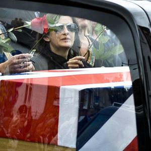 The pregnant girlfriend of Marine James Wright, Shelley Robertson, watches as his coffin arrives in Wootton Basset