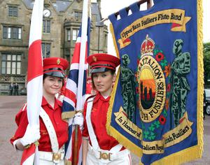 Lindsey Wells (left) and Naomi Little, colour party members of Upper Bann Fusiliers Flute Band wait for the Lurgan Twelfth parade to start.RicPics. 12/7/12.