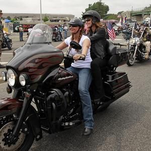 Sarah Palin rides on the back of a motorcycle during a Memorial Day event in Washington (AP)