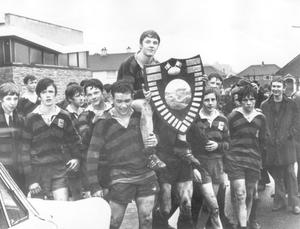 The Ballymena Academy captain Adrian Goodrich is carried shoulder high by his team mates after they had won the Medallion Shield by defeating Methodist College in the final at Ballyclare, 1970.