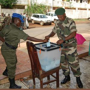 A soldier casts his vote in presidential elections in Conakry, Guinea. The historic elections will go to run-off