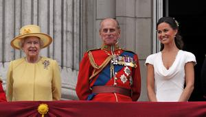 Queen Elizabeth II, the Duke of Edinburgh and Pippa Middleton, appear on the balcony of Buckingham Palace, London, following the wedding of Prince William and Kate Middleton at Westminster Abbey
