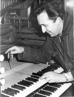 Mr. Gerry Egan working on the organ which is being installed in the Methodist College chapel. The organ is the gift of Corpus Christie College, Cambridge, 1968.