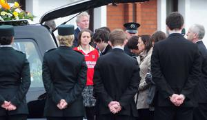 A joint guard of honor from Ronan Kerr's GAA team and his PSNI colleagues at the funeral at Church of the Immaculate Conception, Beragh, Co Tyrone