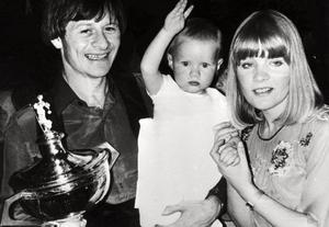 17-05-1982, World Snooker Champion, Alex Higgins is saluted by his baby daughter Lauren with his wife Lynne, after a nail-biting battle against six-times champion Ray Reardon at Sheffield's Crucible Theatre.