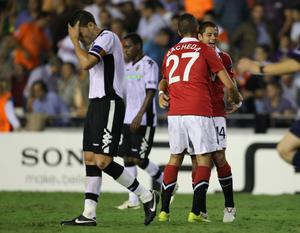 Javier Hernandez of Manchester United celebrates with Federico Macheda after victory over Valencia in the UEFA Champions League Group C match between Valencia and Manchester United at the Mestalla Stadium on September 29, 2010 in Valencia, Spain
