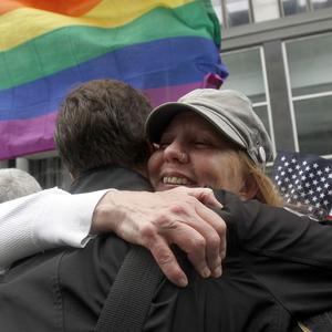 Supporters of gay marriage hug after hearing the decision (AP)