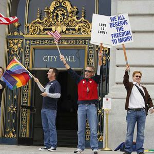 A group celebrate outside San Francisco's City Hall after learning a federal judge had overturned California's same-sex marriage ban (AP)