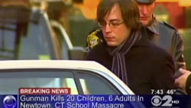 In this frame grab provided by WCBS in New York, Ryan Lanza, the 24-year-old brother of Sandy Hook Elementary School shooter Adam Lanza, is escorted by police into a cruiser in Hoboken, N.J., Friday, Dec. 14, 2012. Adam Lanza, 20, killed his mother at home and then opened fire Friday inside the elementary school where she taught, massacring 26 people, including 20 children, as youngsters cowered in fear to the sound of gunshots echoing through the building and screams coming over the intercom. (AP Photo/WCBS-TV) MANDATORY CREDIT: WCBS-TV