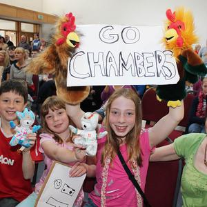 Fans of Richard and Peter Chambers cheer at Coleraine Baptist church as they and Rob Williams and Chris Bartley won GB's fourth silver medal