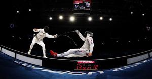 LONDON, ENGLAND - JULY 31:  Alaaeldin Abouelkassem of Egypt competes with Byungchul Choi of Korea in the Men's Foil Individual Semifinal against on Day 4 of the London 2012 Olympic Games at ExCeL on July 31, 2012 in London, England.  (Photo by Hannah Johnston/Getty Images)