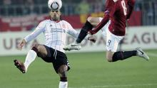 Liverpool's Glen Johnson, left, challenges for the ball with Sparta Prague's Marek Matejovsky, right, during their Europa League soccer match in Prague, Czech Republic, on Thursday, Feb. 17, 2011