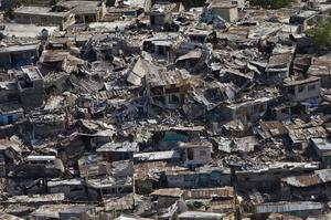 In this photo released by the United Nations, buildings affected by an earthquake lay in ruins in Port-au-Prince, Haiti, Wednesday, Jan. 13, 2010.
