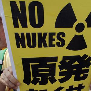 Anti nuclear power protesters near Tokyo demonstrate against bringing the country's first nuclear reactors back online (AP)
