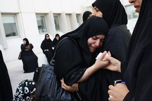 MANAMA, BAHRAIN - FEBRUARY 17:  Women weep outside a hospital morgue after at least three people died and hundreds were left injured when police stormed an anti-government protester camp in the capital's Pearl Square on February 17, 2011 in Manama, Bahrain. Police moved into Pearl Square overnight using batons and tear gas to clear protesters from their makeshift camp, resulting in fatalities and a large number of casualties.  (Photo by John Moore/Getty Images)