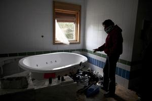 A Libyan surveys a jacuzzi inside a destroyed palace owned by Libyan leader Moammar Gadhafi in the eastern town of Beyda, Libya, Monday, Feb. 28, 2011. The West moved to send its first concrete aid to Libya's rebellion in the east of the country, hoping to give it the momentum to oust Gadhafi. But the Libyan leader's regime clamped down in its stronghold in the capital, quashing an attempt Monday to hold new protests as residents reported skyrocketing food prices from the crisis. (AP Photo/Tara Todras-Whitehill)